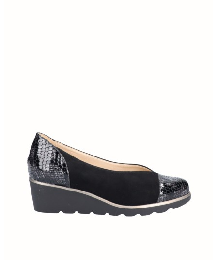 Leather wedge shoe combined with suede and black snake engraved patent leather.